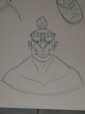 Chieftain: Bust shot of a tough looking orc with crown.
